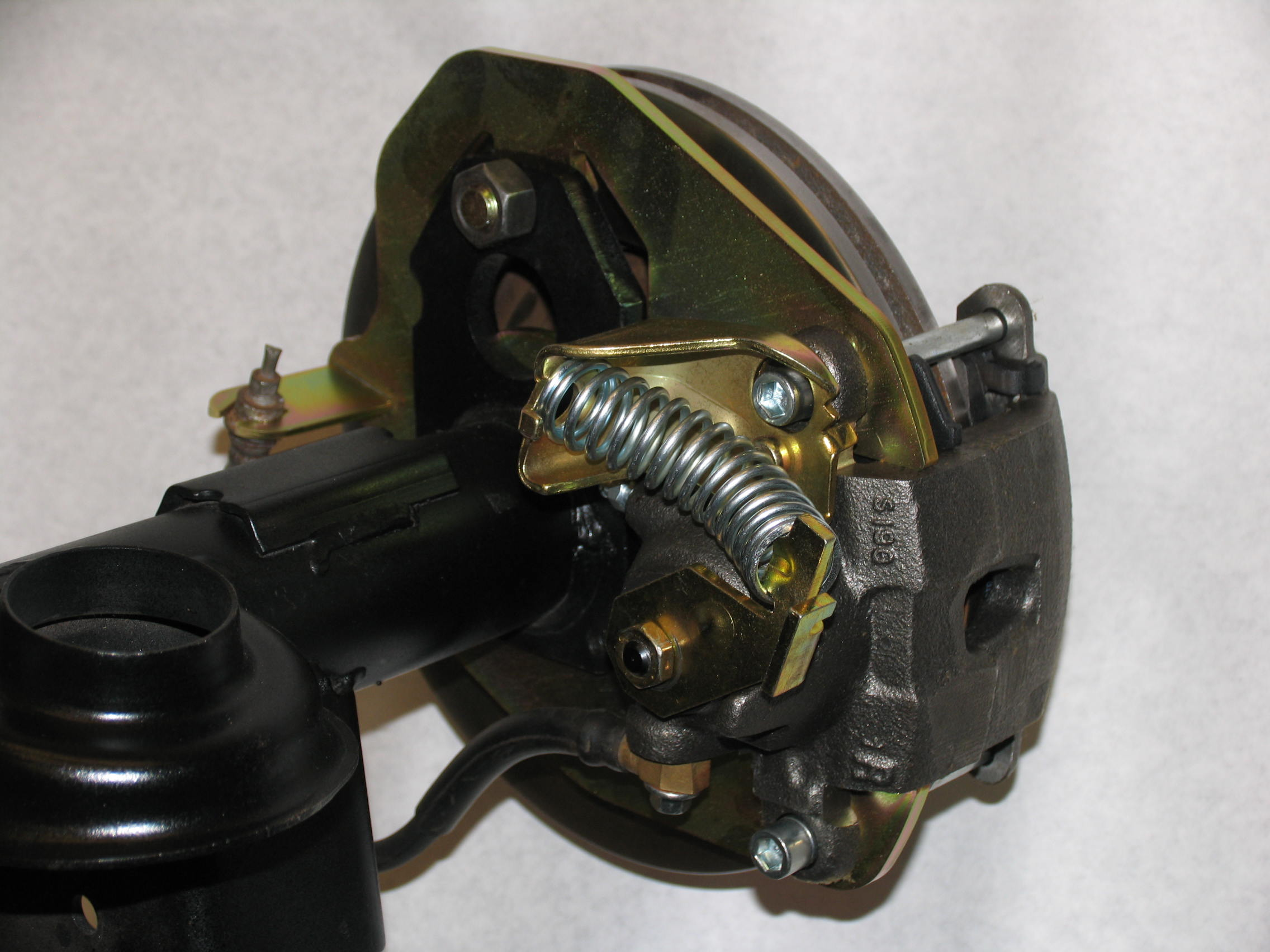 Ca Abc D D Brake Caliper De likewise How To Find And Repair A Brake Fluid Leak Car Raised On Jack With Wheel Removed And Wheel Chock Opposite The Removed Wheel in addition D Just Did Rear Brake Job Pretty Billet Dana Cover as well Disque Frein Ventile in addition Ford F Series Brake Kit. on brake caliper bolts chevy